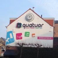 Photo taken at Quatuor by Jon P. on 3/28/2014