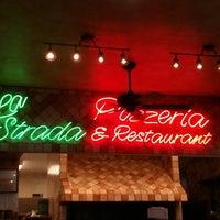 Photo taken at La Strada Pizzeria & Restaurant by Joy O. on 4/4/2013