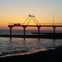 Photo taken at Дикий Пляж by Tatiana M. on 3/9/2015