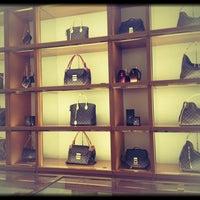 Photo taken at Louis Vuitton by Julia R. on 3/29/2013