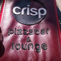 Photo taken at CRISP Pizza Bar & Lounge by Michael W. on 5/5/2013