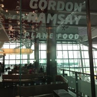 Photo taken at Gordon Ramsay Plane Food by Lorella M. on 10/20/2012