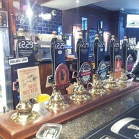 Photo taken at Woodrow Wilson  (Wetherspoon) by Ray C. on 10/2/2013
