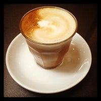 Photo taken at QVB Bar Cafe by Serdar K. on 12/8/2012