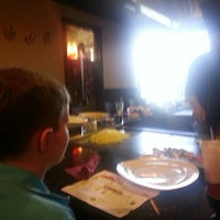 Photo taken at UMI Japanese Steakhouse by Ben M. on 6/1/2014