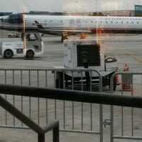 Photo taken at Gate E5 by Esther F. on 12/20/2014