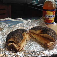 Photo taken at 14th Street Pizza Bagel Cafe by Mike C. on 7/10/2014