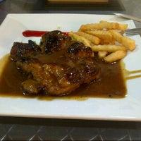 Photo taken at Umi's  Steak & Cafe by Nhzwanie J. on 4/27/2013