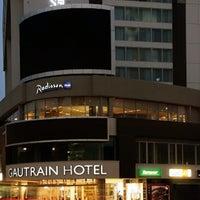 Photo taken at Radisson Blu Gautrain Hotel by Anabella N. on 12/16/2013
