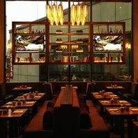 Photo taken at OneUP Restaurant & Lounge by Haroldo F. on 5/26/2013