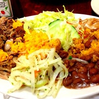 Photo taken at Sophie's Cuban Cuisine by Tom M. on 8/7/2014