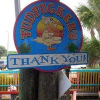 Photo taken at Fudpuckers Beachside Bar & Grill by Scott W. on 7/15/2013
