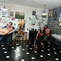 Photo taken at Cia da Tattoo by Alessandra F. on 1/17/2013