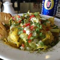 Photo taken at Aromas Café by Rohan A. on 3/16/2013