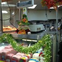 Photo taken at Buy Low Market by Taneshia C. on 11/30/2012