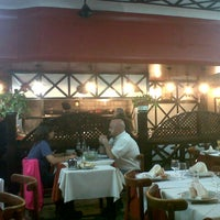 Photo taken at Parrilla Caballito by Paula S. on 3/21/2013