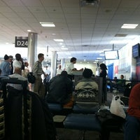 Photo taken at Gate D24 by Stephen G. on 10/22/2012