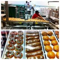 Photo taken at Krispy Kreme Doughnuts by Michael E. on 12/5/2012