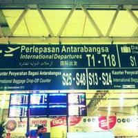 Photo taken at Gate T5 by Rostam S. on 8/22/2013