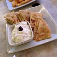 Photo taken at Ammos Authentic Greek Cuisine by Anna B. on 8/22/2013