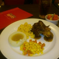 Photo taken at Kenny Rogers Roasters by Albert S. on 5/19/2013