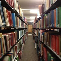 Photo taken at Mugar Library by alice m. on 10/24/2012