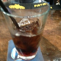 Photo taken at CRISP Pizza Bar & Lounge by Marina B. on 4/6/2013