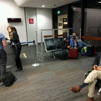 Photo taken at Gate 75 by Cyrus H. on 10/15/2016