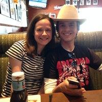 Photo taken at Boston Pizza by Rebecca C. on 7/7/2014