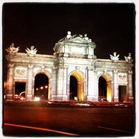 Photo taken at Alcalá Gate by Mari B. on 9/26/2012