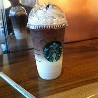 Photo taken at Starbucks by Jakravut L. on 3/15/2013