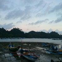Photo taken at Pantai Sendang Biru by Vintage V. on 6/5/2015