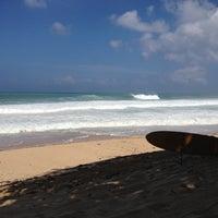 Photo taken at Ehukai Beach by Jessica R. on 10/10/2012
