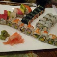 Photo taken at Sushi Cafe by Daniel J. on 10/9/2012