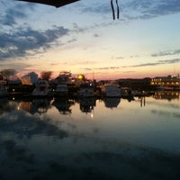 Photo taken at Beach Creek Oyster Bar & Grille by Jaimie V. on 5/17/2013