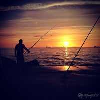 Photo taken at Playa de Salinas / San Juan de Nieva by GUAGUO I. on 6/14/2013
