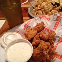 Photo taken at Hooters Restaurant by Y S. on 6/25/2013