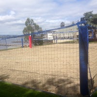Photo taken at Houghton Beach Volleyball by Michael B. on 4/11/2014