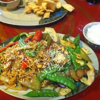Photo taken at Khan's Mongolian Barbeque by Erin H. on 5/24/2013