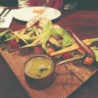 Photo taken at Andre's Cucina & Polenta Bar by Jennifer L. on 5/8/2013