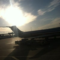 Photo taken at Gate C31 by Kevin R. on 12/7/2012