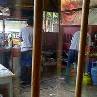 Photo taken at Batagor H. Isan by Yuli K. on 10/14/2012
