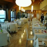 Photo taken at Laguna Palace Hotel by Nicola G. on 1/15/2013