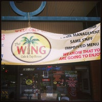 Photo taken at The Wing Cafe and Tap House by Wesley C. on 5/31/2013