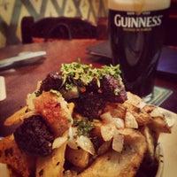 Photo taken at Fadó Irish Pub & Restaurant by Walkerscoop on 7/28/2013