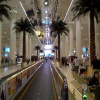 Photo taken at Dubai International Airport (DXB) by Fouad Z. on 6/29/2013