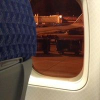 Photo taken at Gate 47A by Alex A C. on 12/5/2013