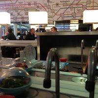 Photo taken at YO! Sushi by Simon L. on 1/28/2013
