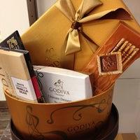 Photo taken at Godiva Chocolatier by Adebayo A. on 9/27/2012