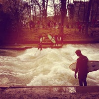 Photo taken at Eisbach Wave by Bastian D. on 4/13/2013